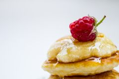 Stack of pancakes on plate with raspberries and Royalty Free Stock Photography