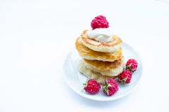 Stack of pancakes on plate  raspberries and sour Royalty Free Stock Images
