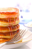 A stack of pancakes on a plate with syrup fruity Stock Photos
