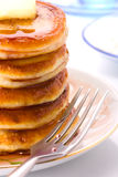A stack of pancakes on a plate with syrup fruity Royalty Free Stock Photos