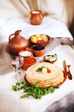 Stack pancakes with red caviar and parsley butter rural rustic still life pottery canvas village Stock Photo