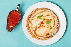 Stack of pancakes with red  caviar Royalty Free Stock Image