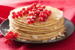 Stack of pancakes with redcurrant and powder sugar Royalty Free Stock Photo