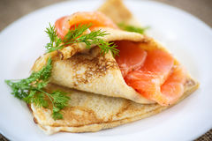 Stack of pancakes with salted salmon Royalty Free Stock Photos