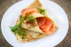 Stack of pancakes with salted salmon Royalty Free Stock Images