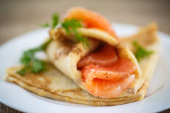 Stack of pancakes with salted salmon Royalty Free Stock Photo