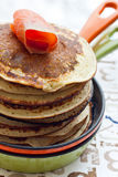 Stack of pancakes with smoked salmon. On the pan stock images