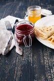 A stack of pancakes with honey for Maslenitsa. A stack of pancakes with sour cream and honey for Maslenitsa stock photos