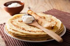 Stack of pancakes with sour cream Royalty Free Stock Images