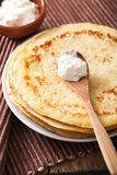 Stack of pancakes with sour cream Stock Photography