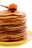 Stack of pancakes and a spoon with red caviar. Stock Photos