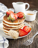 Stack of pancakes with strawberry and honey Stock Photography