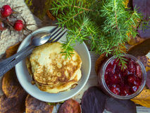 Stack of pancakes with strawberry jam. Stack pancakes with strawberry jam on a rustic wooden table Royalty Free Stock Photo