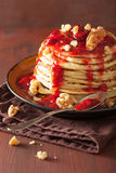 Stack of pancakes with strawberry jam and walnuts. tasty dessert Royalty Free Stock Photos