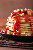 Stack of pancakes with strawberry jam and walnuts. tasty dessert Royalty Free Stock Photo