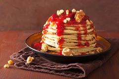 Stack of pancakes with strawberry jam and walnuts. tasty dessert Stock Images