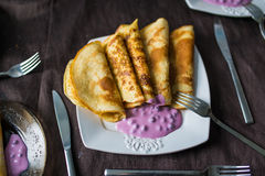 Stack of pancakes with sweet blueberry sauce Stock Image