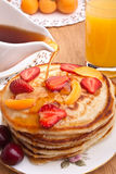 Stack of pancakes with syrup Stock Photography