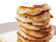 Stack of pancakes, syrup isolated on white background. Honey or syrup, pancakes stack isolated on white background royalty free stock photography