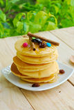 Stack of pancakes and syrup in plate on wooden table Royalty Free Stock Photography