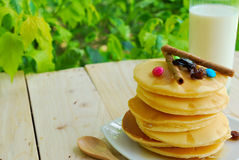 Stack of pancakes and syrup in plate on wooden table Stock Images