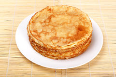Stack of pancakes on white plate Royalty Free Stock Images