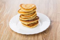 Stack of pancakes in white plate on table Royalty Free Stock Photo