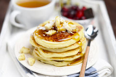 Stack of pancakes on white tray, breakfast in bed Royalty Free Stock Images