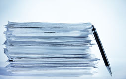 Stack of paper. A pen near stack of paper Royalty Free Stock Image