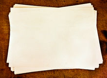 Stack of paper. Stack of paper on a wooden background Royalty Free Stock Images