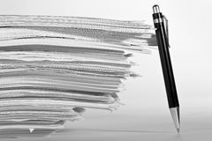 Stack of paper. A pen near stack of paper Stock Images