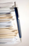 Stack of paper. A pen near stack of paper Stock Image