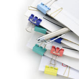 Stack of paper. With pen on white background Stock Photo