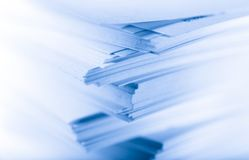 Stack of paper cards. In blue Stock Photo