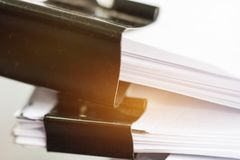 Stack of Paper documents with clip, Pile of unfinished documents stock photos