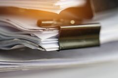 Stack of Paper documents with clip, Pile of unfinished documents royalty free stock images
