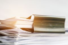 Stack of Paper documents with clip, Pile of unfinished documents. On office desk folders. Business papers for Annual Report files, Document is written,presented royalty free stock photo