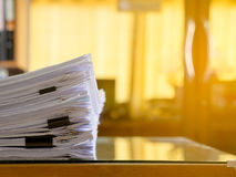 Stack of paper files on work desk in office. Royalty Free Stock Photos