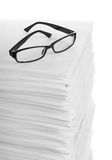 Stack of paper and glasses lying on it Royalty Free Stock Photography