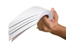 A stack of paper in hand. Isolated on white background Royalty Free Stock Photography