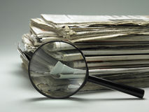 Stack of paper and magnifier Stock Photography