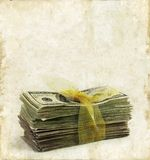 Stack of Paper Money on a Grunge Background Stock Photos