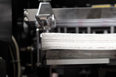 Stack of paper in a printing press Royalty Free Stock Image