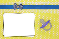 Stack of paper sheets and blue pacifier Royalty Free Stock Images