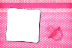 Stack of paper sheets and pink pacifier Royalty Free Stock Images