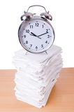 Stack of papers and clock Stock Photography