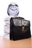 Stack of papers and clock Royalty Free Stock Photos