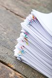Papers with paperclips. Stack of papers with paperclips on wooden table Stock Images