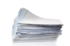 Stack of papers  on white. Stock Image