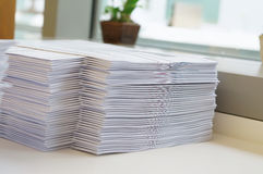 Stack of papers worksheet near window Stock Photography